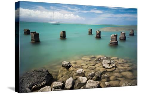 Concrete Pylons of an Old Wharf Stand Sentinel in the Turquoise Kalohi Channel-Jonathan Kingston-Stretched Canvas Print
