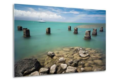 Concrete Pylons of an Old Wharf Stand Sentinel in the Turquoise Kalohi Channel-Jonathan Kingston-Metal Print