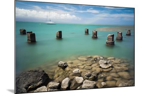 Concrete Pylons of an Old Wharf Stand Sentinel in the Turquoise Kalohi Channel-Jonathan Kingston-Mounted Photographic Print