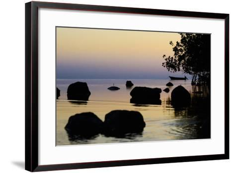 A Lone Fishing Boat Is Anchored at Sunset Near a Mangrove Forest on Molokai-Jonathan Kingston-Framed Art Print