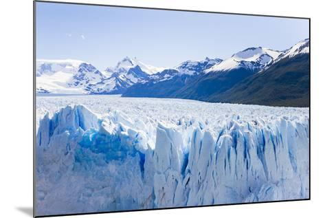 Deep Blue Cracks Line the Front Wall of the Perito Moreno Glacier-Mike Theiss-Mounted Photographic Print