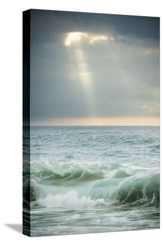 Sun Rays Break Through the Clouds over the Pacific on the West Shore of Molokai, Hawaii-Jonathan Kingston-Stretched Canvas Print