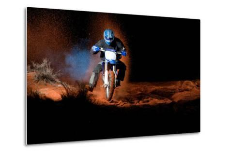 A Motorcyclist Rides on Sand Dunes, with Clouds of Sand and Smoke Behind Him-Keith Ladzinski-Metal Print