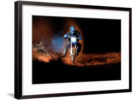 A Motorcyclist Rides on Sand Dunes, with Clouds of Sand and Smoke Behind Him-Keith Ladzinski-Framed Art Print