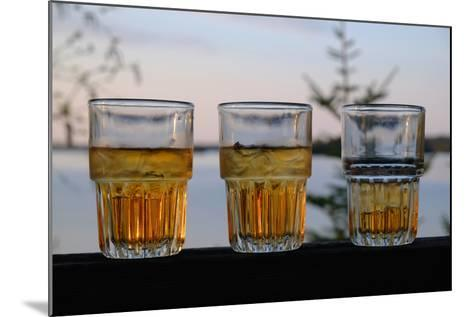Three Glasses of Brandy Old Fashions on the Railing of a Wooden Deck-Paul Damien-Mounted Photographic Print