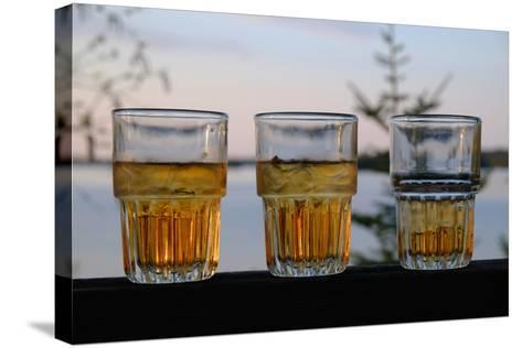 Three Glasses of Brandy Old Fashions on the Railing of a Wooden Deck-Paul Damien-Stretched Canvas Print