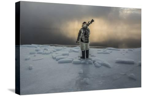 An Inuit Hunter on the Sea Ice-Cristina Mittermeier-Stretched Canvas Print