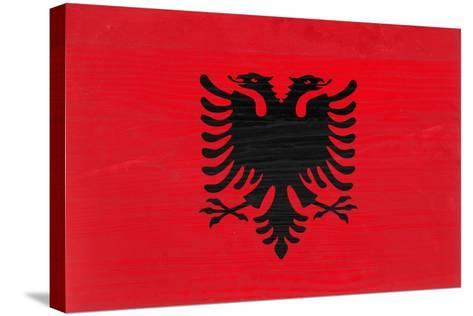Albania Flag Design with Wood Patterning - Flags of the World Series-Philippe Hugonnard-Stretched Canvas Print