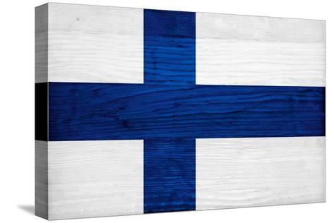Finland Flag Design with Wood Patterning - Flags of the World Series-Philippe Hugonnard-Stretched Canvas Print