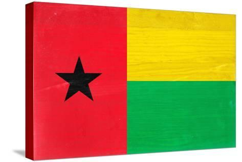 Guinea-Bissau Flag Design with Wood Patterning - Flags of the World Series-Philippe Hugonnard-Stretched Canvas Print