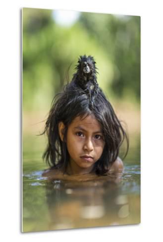 A Pet Saddleback Tamarin Hangs on Tight to a Matsigenka Girl as She Swims in the Yomibato River-Charlie Hamilton James-Metal Print