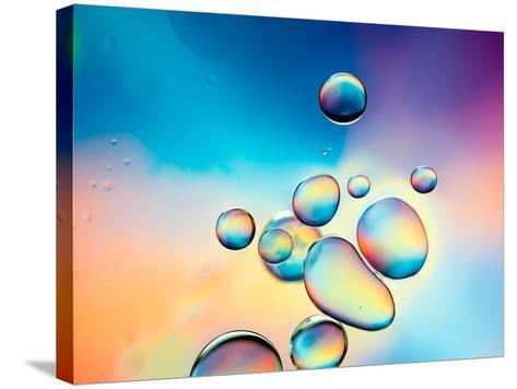 Macro of Oil Drops on Water Surface with Vibrant Colors in Background- Abstract Oil Work-Stretched Canvas Print