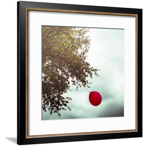 A Red Balloon Hanging on a Tree-Joana Kruse-Framed Art Print