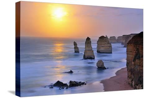 Moonset over Twelve Apostles in Victoria, Australia-Nokuro-Stretched Canvas Print