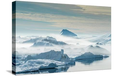 Huge Stranded Icebergs at the Mouth of the Icejord Near Ilulissat at Midnight, Greenland-Luis Leamus-Stretched Canvas Print