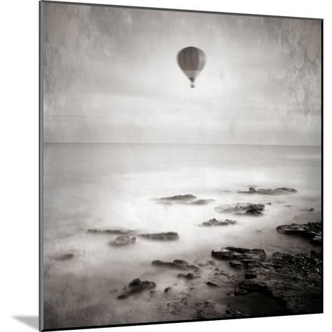 A Hot Air Balloon Floating Above the Sea-Trigger Image-Mounted Photographic Print