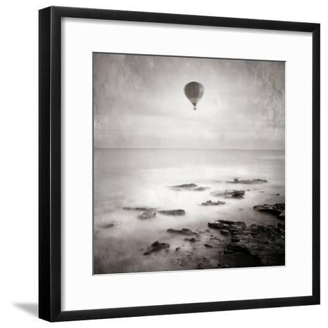 A Hot Air Balloon Floating Above the Sea-Trigger Image-Framed Art Print