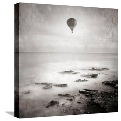 A Hot Air Balloon Floating Above the Sea-Trigger Image-Stretched Canvas Print