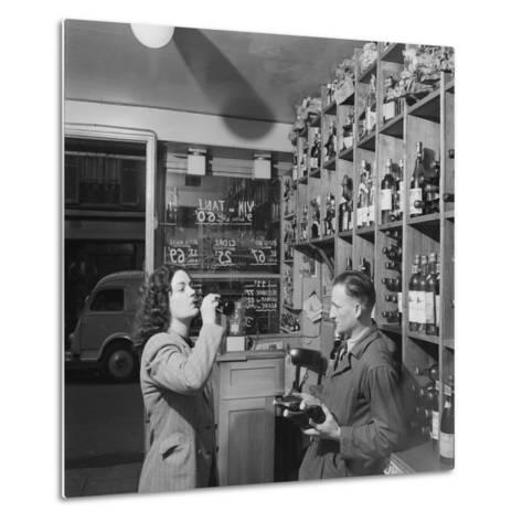 Young Woman Drinking a Bottle of Coca Cola in a Shop, Paris, France, 1950-Mark Kauffman-Metal Print