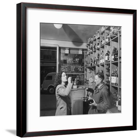 Young Woman Drinking a Bottle of Coca Cola in a Shop, Paris, France, 1950-Mark Kauffman-Framed Art Print
