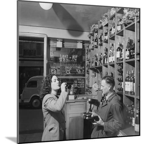 Young Woman Drinking a Bottle of Coca Cola in a Shop, Paris, France, 1950-Mark Kauffman-Mounted Photographic Print