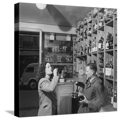 Young Woman Drinking a Bottle of Coca Cola in a Shop, Paris, France, 1950-Mark Kauffman-Stretched Canvas Print
