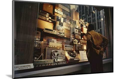 Man Looks at a Window Display of an Electronics Store, New York, New York, 1963-Yale Joel-Mounted Photographic Print