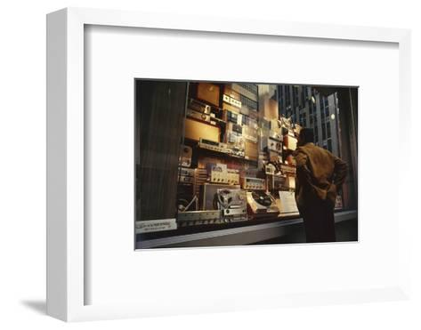 Man Looks at a Window Display of an Electronics Store, New York, New York, 1963-Yale Joel-Framed Art Print