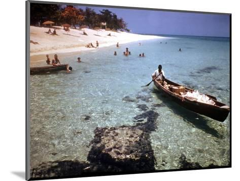 1946: Sam Cunningham Sells Sea Shells to Tourist Along the Seashore in Montego Bay, Jamaica-Eliot Elisofon-Mounted Photographic Print