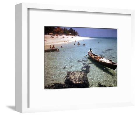 1946: Sam Cunningham Sells Sea Shells to Tourist Along the Seashore in Montego Bay, Jamaica-Eliot Elisofon-Framed Art Print