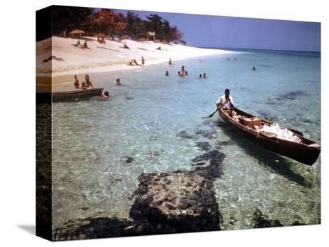 1946: Sam Cunningham Sells Sea Shells to Tourist Along the Seashore in Montego Bay, Jamaica-Eliot Elisofon-Stretched Canvas Print