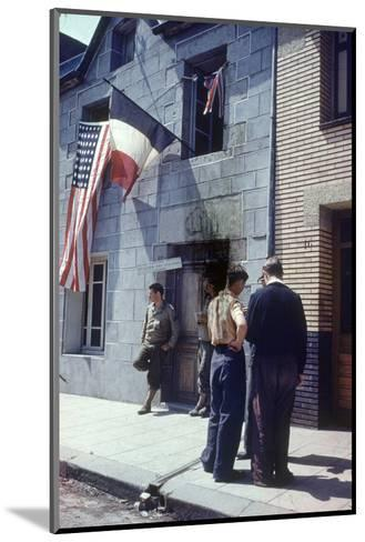Civil Affairs Building in La Haye Du Puit Decorated with American and French Flags, France, 1944-Frank Scherschel-Mounted Photographic Print