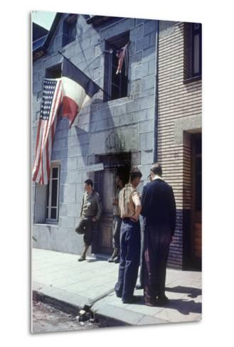 Civil Affairs Building in La Haye Du Puit Decorated with American and French Flags, France, 1944-Frank Scherschel-Metal Print