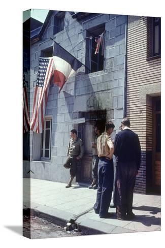 Civil Affairs Building in La Haye Du Puit Decorated with American and French Flags, France, 1944-Frank Scherschel-Stretched Canvas Print
