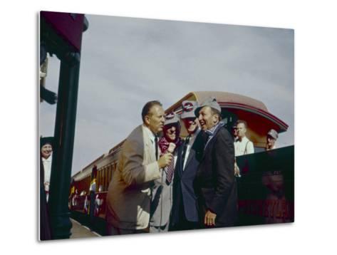 Walt Disney Being Interviewed by Train at Disneyland. Anaheim, California 1955-Allan Grant-Metal Print