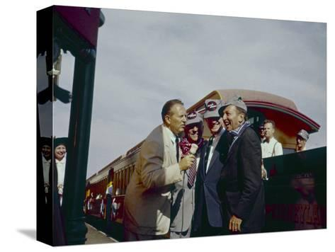 Walt Disney Being Interviewed by Train at Disneyland. Anaheim, California 1955-Allan Grant-Stretched Canvas Print