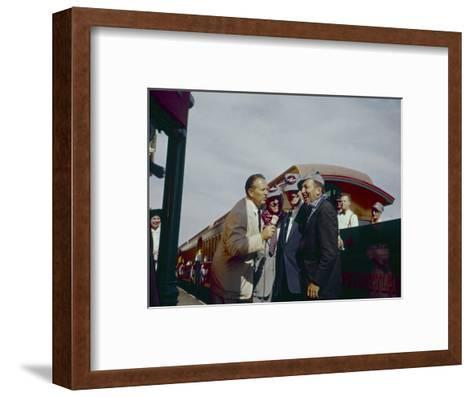 Walt Disney Being Interviewed by Train at Disneyland. Anaheim, California 1955-Allan Grant-Framed Art Print