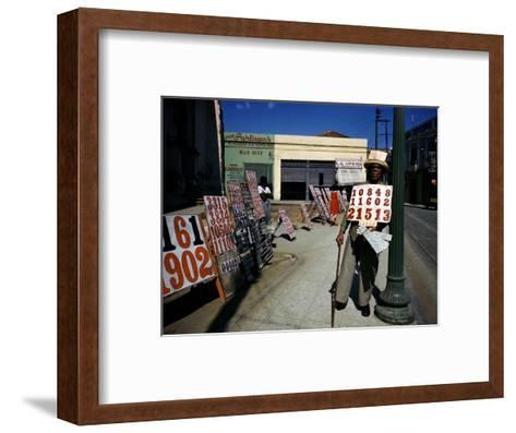 December 1946: War Veteran Sells Lottery Tickets for the Government Lottery in Camaguey, Jamaica-Eliot Elisofon-Framed Art Print