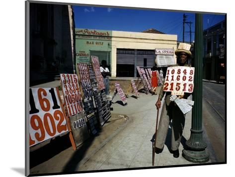 December 1946: War Veteran Sells Lottery Tickets for the Government Lottery in Camaguey, Jamaica-Eliot Elisofon-Mounted Photographic Print