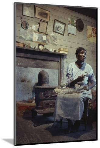 Woman with Cotton Stalks Beside a Wood-Burning Stove, Edisto Island, South Carolina, 1956-Walter Sanders-Mounted Photographic Print