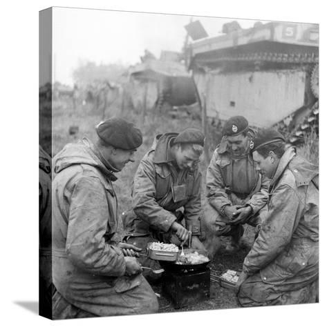 Members of the British 49th Armoured Personnel Carrier Regiment Cooking on the Side of a Road-George Silk-Stretched Canvas Print