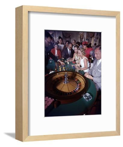 February 11, 1957: Tourists Gambling at the Nacional Hotel in Havana, Cuba-Ralph Morse-Framed Art Print