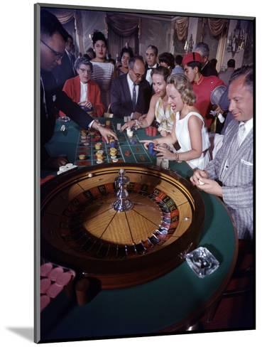 February 11, 1957: Tourists Gambling at the Nacional Hotel in Havana, Cuba-Ralph Morse-Mounted Photographic Print