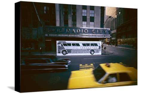 Poster of a Greyhound Bus in Front of Radio City Music Hall, New York, New York, Summer 1967-Yale Joel-Stretched Canvas Print