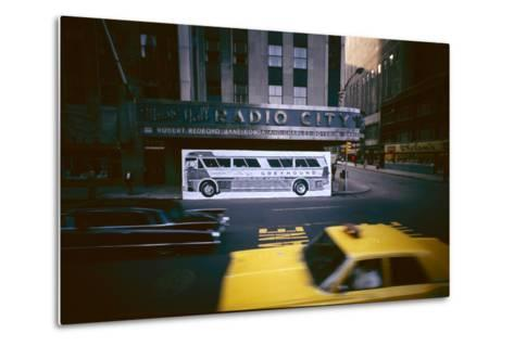 Poster of a Greyhound Bus in Front of Radio City Music Hall, New York, New York, Summer 1967-Yale Joel-Metal Print