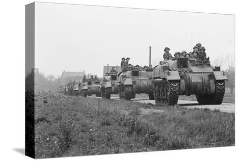 Members of the British 49th Armoured Personnel Carrier Regiment Riding Along a Line of Tanks-George Silk-Stretched Canvas Print