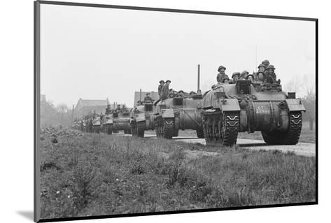 Members of the British 49th Armoured Personnel Carrier Regiment Riding Along a Line of Tanks-George Silk-Mounted Photographic Print