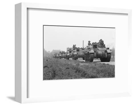 Members of the British 49th Armoured Personnel Carrier Regiment Riding Along a Line of Tanks-George Silk-Framed Art Print