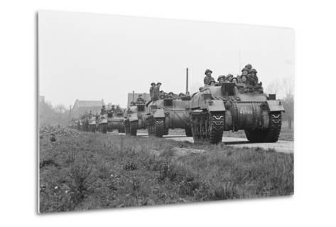 Members of the British 49th Armoured Personnel Carrier Regiment Riding Along a Line of Tanks-George Silk-Metal Print