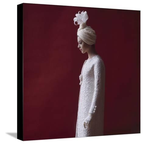 Model Dressed in a White Turban, Gloves, and Brocade Coat by Yves St Laurent, Paris, France, 1962-Paul Schutzer-Stretched Canvas Print